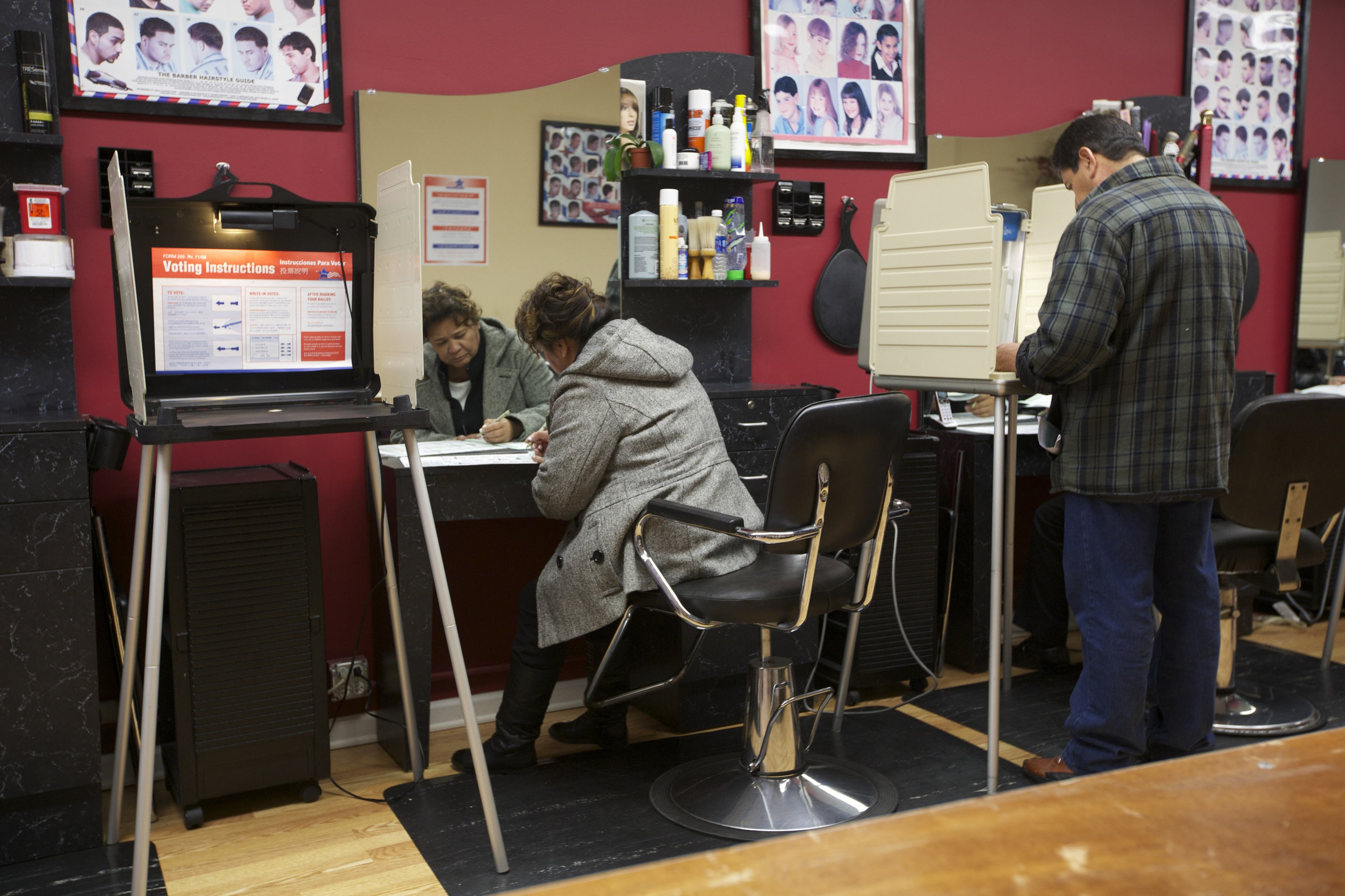Aracle Garcia casts her ballot during the U.S. presidential election at Delias Beauty Salon in Chicago