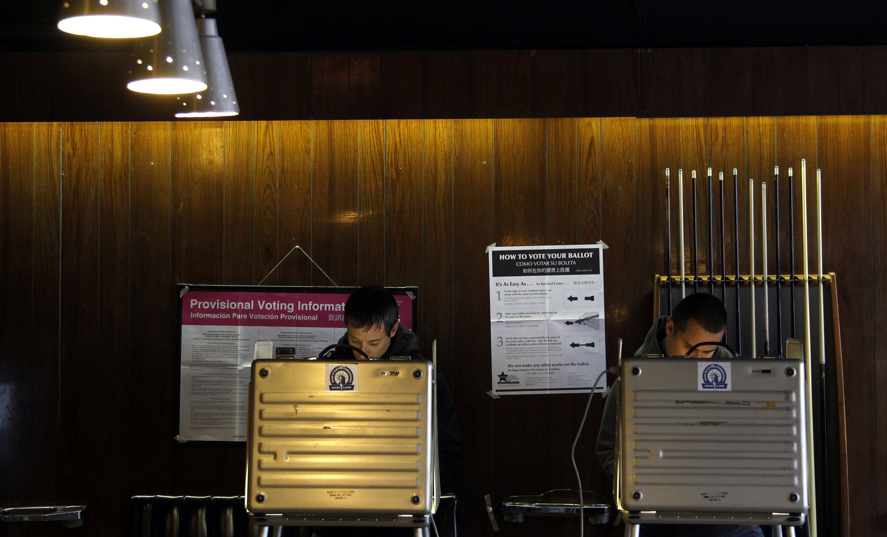 Voters cast their votes at Marie's Golden Cue pool hall during the U.S. presidential election in Chicago